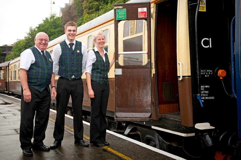 Catering Staff welcoming passengers to the train